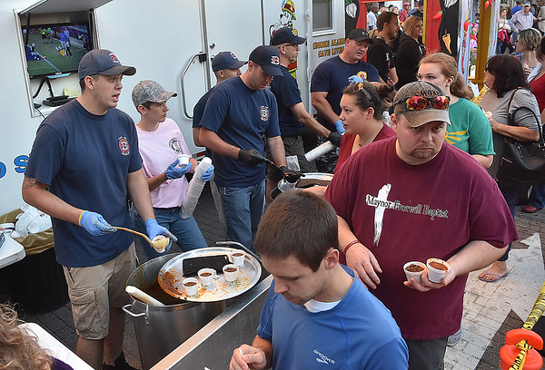 (Brad Davis/The Register-Herald) Beckley Fire Department dishes out fire, in chili form, during Beckley's annual Chili Night event Saturday evening.