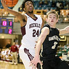 (Brad Davis/The Register-Herald) Woodrow Wilson's Courtney Walton scores as University's Kaden Metheny defends during Big Atlantic Classic action Saturday night at the Beckley-Raleigh County Convention Center.