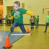 (Brad Davis/The Register-Herald) Kindergartener Aiden Clark clears another obstacle as he jumps away some extra energy during Maxwell Hill Elementary's Jumping for Hearts event Friday afternoon in the school's gymnasium. Students spent several days gathering donations for the American Heart Association by sending out e-mails, asking friends and family or even going door-to-door in their neighborhoods if they wised, raising around $5,000 overall. The annual event concluded with a special celebration in the gym where students got to run and play in a variety of jumping-related activities.