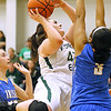 (Brad Davis/The Register-Herald) Wyoming East's Allie Lusk drives to the basket as St. Joseph Central's Kendra Ziegler, right, and Dena Jarrells defend during the Lady Warriors' win over the Irish Friday night in New Richmond.