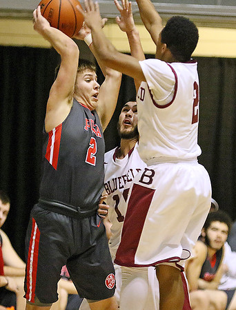 (Brad Davis/The Register-Herald) Poca's Carson Cottrill looks for an open teammate as he's pressured by Bluefield defender Donta Hopkins during Big Atlantic Classic action Saturday afternoon at the Beckley-Raleigh County Convention Center.