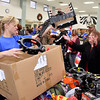 (Brad Davis/The Register-Herald) Volunteer Hope McNeely, left, helps Debbie Hylton, right, pick out toys during the Wyoming County Toy Fund Sunday morning at Wyoming East High School.