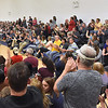 (Brad Davis/The Register-Herald) The crowd of residents numbering in the hundreds rises to its feet and applauds in response to multiple speeches in opposition to the possible closing of Valley High School during a public hearing at the school Thursday evening in Smithers.