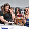 (Brad Davis/The Register-Herald) Family members shed a few tears along with the smiles as they watch and record their graduating seniors collecting their diplomas during Independence High School's 41st Commencement Saturday morning at the Beckley-Raleigh County Convention Center.