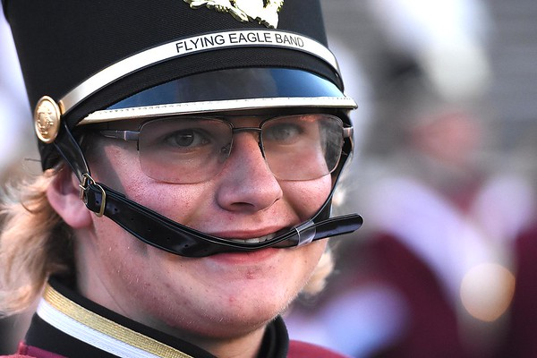 Logan Calfee, band member for Woodrow Wilson High School, watches the action against Cabell Midland Friday night at Van Meter Stadium in Beckley.<br /> (Rick Barbero/The Register-Herald)