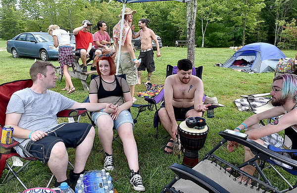 (Brad Davis/The Register-Herald) A group mostly Huntington residents chill out in some shade after getting their camp set up during the opening hours of the Cluster Music & Arts Festival going on this weekend at Ace Adventure Resort Thursday afternoon in Minden. From left (sitting) is Craig Smoot, Savannah Lambert, James Deitzler of Charleston and Kendall Nall. Running through Sunday afternoon, it's a smaller event than the annual Mountain Music Festival but comes with a similar crowd and vibe.