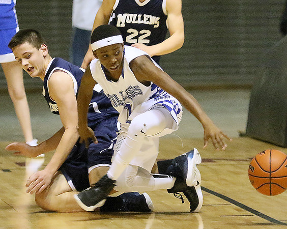 (Brad Davis/The Register-Herald) Beckley-Stratton's B.J. Mitchell scrambles for a loose ball with Mullens' Dakota McBride during the Big Atlantic Classic boys middle school championship game Wednesday afternoon at the Beckley-Raleigh County Convention Center.