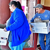 (Brad Davis/The Register-Herald) Volunteers set out to make deliveries around the area during Lewis Christian Community Center's Thanksgiving dinner Thursday afternoon in Oak Hill.