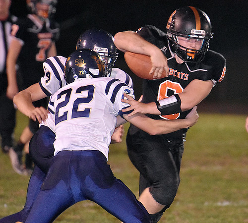 (Brad Davis/The Register-Herald) Summers County's Marcus McGuire rumbles ahead as Greenbrier West's Kaiden Pack (#22) and John Parks Friday night in Hinton.