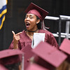 (Brad Davis/The Register-Herald) Woodrow Wilson senior Lyric Moon reacts after collecting his diploma during the school's 91st Commencement Saturday evening at the Beckley-Raleigh County Convention Center.
