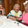 Ashley Thomas, 26  left, watches her grandmother Margaret Williams, 70, and her daughter Karmyn Thomas, 5, play war with cards.<br /> (Rick Barbero/The Register-Herald)