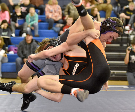 (Brad Davis/The Register-Herald) River View's Josh Walker takes on Richwood's Kyle Perry in a 138-pound weight class matchup Saturday afternoon at Shady Spring High School.