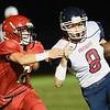 Cruize Carico, left of Liberty, tries to take down, Adams Daniels, of Independence  during game  Friday night at Liberty High School.<br /> (Rick Barbero/The Register-Herald)