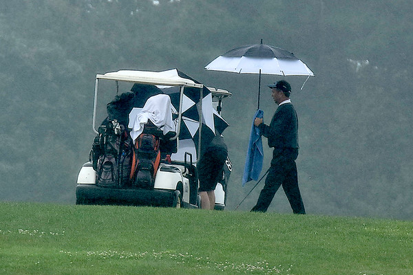 (Brad Davis/The Register-Herald) A fine, chilly rain made conditions tough for a moment at the BNI Saturday afternoon at Grandview Country Club.