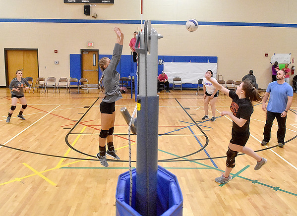 (Brad Davis/The Register-Herald) The Bobcats, left, take on Team Kevin during a Volleyball 4 Autism fundraising event at Memorial Baptist Church Saturday morning. Several co-ed teams from all over the area hits the courts to help raise money for Un-Prescription, a non-profit organization that works to educate autism families and healthcare professionals about the invisible challenges of the autism spectrum.