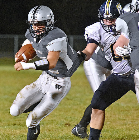(Brad Davis/The Register-Herald) Westside's Matt Blankenship carries the ball as Nicholas County defender Colton Groves manages to get ahold of his jersey Friday night in Clear Fork.