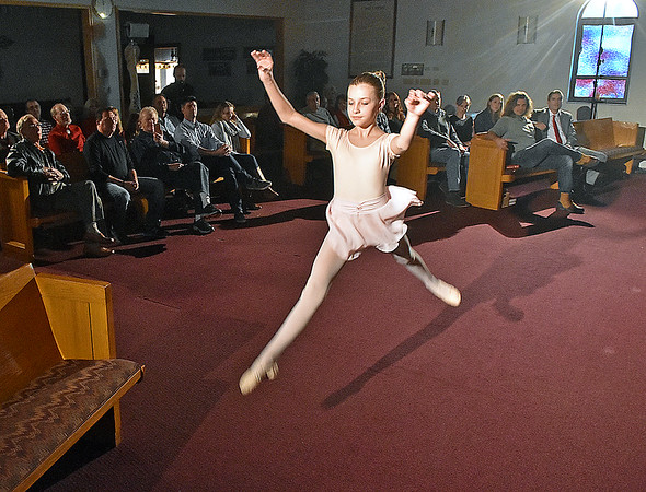 (Brad Davis/The Register-Herald) Young actress and performer Brooklyn Nelson dances as she and JCFilms crew members film scenes for a movie adapted to local author Eleanor Wright's book entitled Megan's Christmas Miracle inside Hollywood Missionary Baptist Church Saturday evening. A handful scenes in the movie will feature several local residents as extras, photographed in the background.
