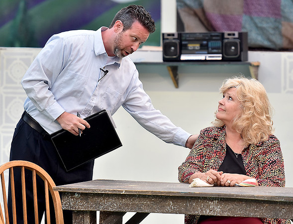(Brad Davis/The Register-Herald) Rev. Shaw Moore, played by Jamie Rogers, talks with wife Vi, played by Regina Brown, during a scene from Theatre West Virginia's Footloose at Grandview Park's Cliffside Amphitheatre.