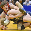 (Brad Davis/The Register-Herald) Independence's Hunter Taylor takes on Madonna'a Alec Cook in the 132-pound weight class championship match during the 70th Annual WVSSAC State Wrestling Tournament Saturday night at the Big Sandy Arena in Huntington. Indy's Taylor won the match.
