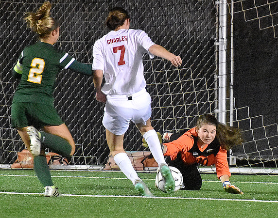 (Brad Davis/The Register-Herald) Cabell Midland's Emilie Charles rushes in past Greenbrier East defender Kellen Bartenslager, left, to tap the game winning goal into the net before goalkeeper Mallory Alderson can secure the loose ball during Class AAA Girls State Soccer Tournament action Friday night the YMCA Paul Cline Memorial Sports Complex.