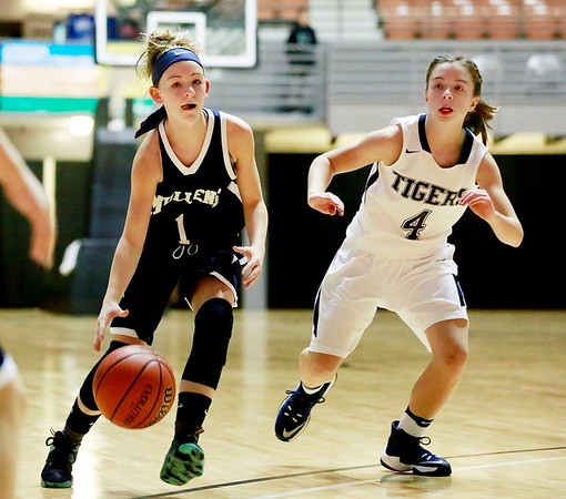 Mullens' Skylar Davidson (1) drives past Shady Spring's Brooklyn Gibson (4) during the Big Atlantic Classic Tuesday in Beckley. (Chris Jackson/The Register-Herald)