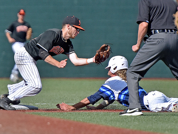 (Brad Davis/The Register-Herald) Shepherd's Trenton Burgreen dives in to steal 2nd before West Virginia Wesleyan 2nd baseman Tre Kerns can get the tag down during Mountain East Conference Tournament action Saturday afternoon at Linda K. Epling Stadium.
