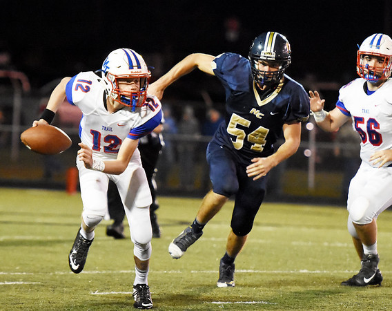 Midland Trail's quarterback  Austin Issacs(12) runs form the pocket during their football game against Nicholas County Friday in Summersville. (Chris Jackson/The Register-Herald)