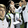 A Fayetteville High School band member yells as they finish a song during their football game against Meadow Bridge Friday in Meadow Bridge. (Chris Jackson/The Register-Herald)
