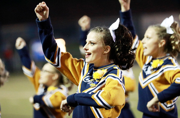 Nicholas County cheerleaders cheer on their team as they play James Monroe Friday in Summersville. (Chris Jackson/The Register-Herald)