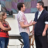 (Brad Davis/The Register-Herald) An initial meeting between Ren (middle), played Holden Akers-Toler, and Molly's dad Rev. Moore, played by Jamie Rogers, doesn't go over so well during a scene from Theatre West Virginia's Footloose at Grandview Park's Cliffside Amphitheatre.