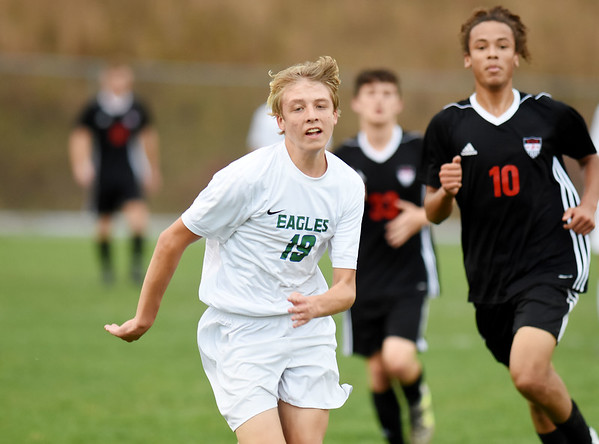 Robert C Byrd's Logan Parsons chases down a ball during their semi-final AA-A boys soccer match against Weir during the West Virginia State Soccer Tournament in Beckley on Friday. (Chris Jackson/The Register-Herald)