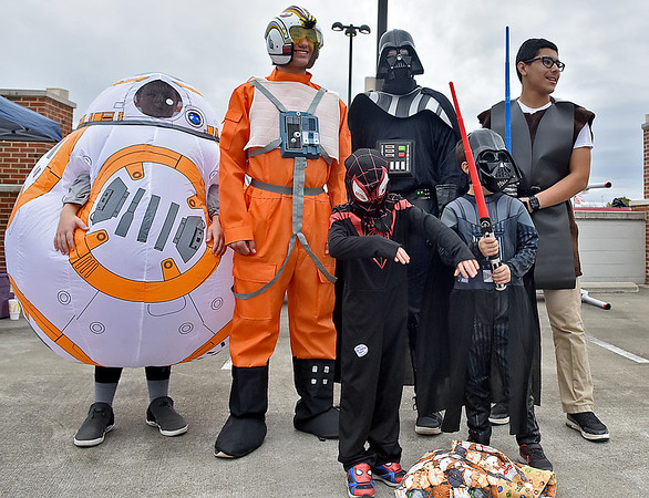 (Brad Davis/The Register-Herald) Spider Man fan Alex Mullins, 8, gets a quick photo with Family Worship Center members dressed up in a Star Wars theme during Tailgate Halloween Saturday afternoon atop Beckley's Intermodal Gateway.