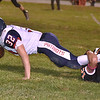 (Brad Davis/The Register-Herald) Independence's Jared Goddard stretches out for as many yards as he can get as he's taken down by a Summers County defender Friday night in Hinton.