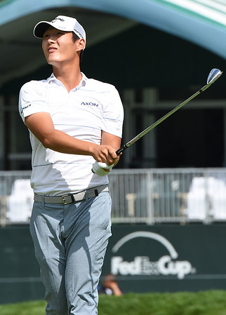 Danny Lee looks over his tee shot on the 18th hole during the second round of The Greenbrier Classic.<br /> (Rick Barbero/The Register-Herald)