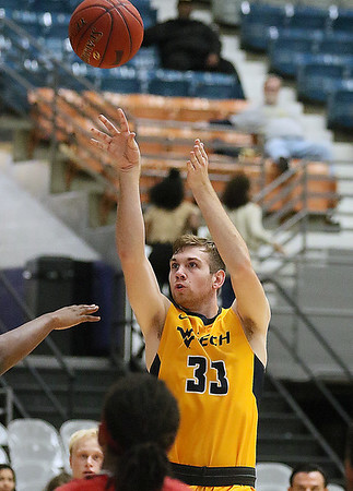 (Brad Davis/The Register-Herald) WVU Tech's Brent Daniels pulls up for a mid-range jumper against Davis & Elkins Saturday afternoon at the Beckley-Raleigh County Convention Center.