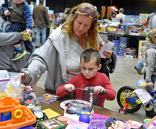 (Brad Davis/The Register-Herald) Six-year-old Gage Butler and grandmother Anna check out all the toys during the annual Mac's Toy Fund event Saturday morning at the Beckley-Raleigh County Convention Center.