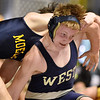 (Brad Davis/The Register-Herald) Greenbrier West's Colton Kessler takes on Moeller's Zach Taylor in a 160-pound weight class matchup during the West Virginia Army National Guard Duals Friday afternoon at the Beckley-Raleigh County Convention Center. West's Kessler would win the match.