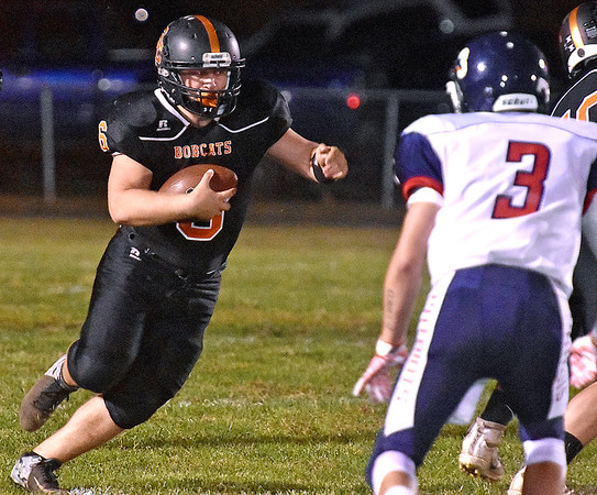 (Brad Davis/The Register-Herald) Summers County's Marcus McGuire carries the ball against Independence Friday night in Hinton.