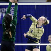 (Brad Davis/The Register-Herald) Greenbrier West's Alexis Vestal spikes the ball as East Hardy's Jessica Smith tries to block it during State Volleyball Tournament action Friday morning at the Charleston Civic Center.