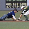 (Brad Davis/The Register-Herald) Miners 2nd baseman Kyle Bergeron catches Butler baserunner Pavin Parks snoozing and tags him out on a pickoff throw from catcher Brent Todys to end the Blue Sox 6th inning Wednesday night at Linda K. Epling Stadium.