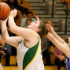 (Brad Davis/The Register-Herald) Greenbrier East's Piper Nunley drives and scores as Princeton's Jamie Vest defends during Friday night's sectional championship game in Fairlea.