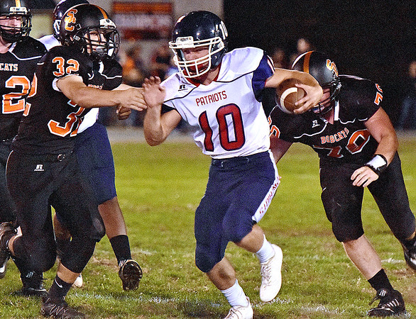 (Brad Davis/The Register-Herald) Independence's Connor Gibson slices between Summers County defenders Trent Meador, left, and Ethan Koenig Friday night in Hinton.