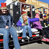 (Brad Davis/The Register-Herald) Participants toss candy to the masses as they make their way along Main Street in Sophia during the town's annual Christmas Parade Saturday afternoon.