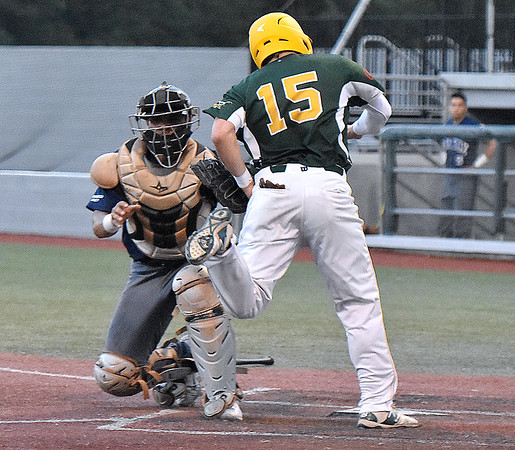(Brad Davis/The Register-Herald) Miners outfielder Nick Delgado doesn't slide and is ultimately tagged out at the plate by Butler catcher Rey Gonzalez after teammate Justin Mitchell's double during the 5th inning Wednesday night at Linda K. Epling Stadium.