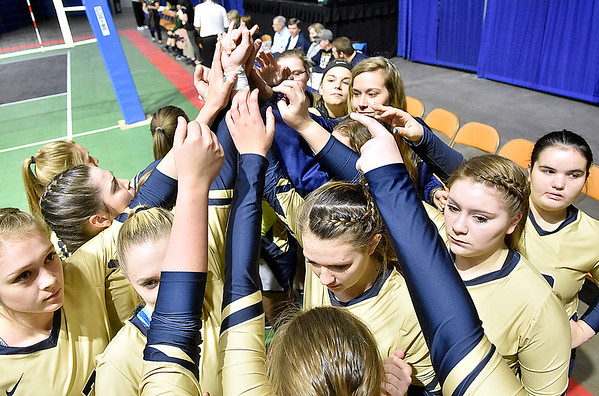 (Brad Davis/The Register-Herald) The Lady Cavs come together to before the start of Greenbrier West's match against East Hardy during State Volleyball Tournament action Friday morning at the Charleston Civic Center.