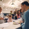 Lucy Skelding, 8, from Lewisburg, talks with WVSOM medical student Kyle Varon as her sister Hatcher, 5, draws her favorite animal during the WVSOM Science Fair Carnival in Lewisburg Saturday. Varon was showing microhabitats at his booth. (Chris Jackson/The Register-Herald)
