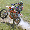 (Brad Davis/The Register-Herald) A competitor tries to keep control as they tear through a section of the course during Sprint Enduro Series dirt bike racing Sunday afternoon at Hidden Valley Golf in Glen Daniel.