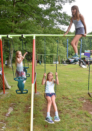 (Brad Davis/The Register-Herald) The Rodes sisters, all the way from Niantic, Connecticut together on a swingset during the annual Lilly Family Reunion Saturday afternoon. From left, 5 and 1/2-year-old Madeline, 9-year-old Abigail and 10-year-old Samantha.