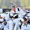 (Brad Davis/The Register-Herald) The Shepherd Rams pile on in celebration after defeating the University of Charleston in the Mountain East Conference Championship game Sunday evening at Linda K. Epling Stadium.