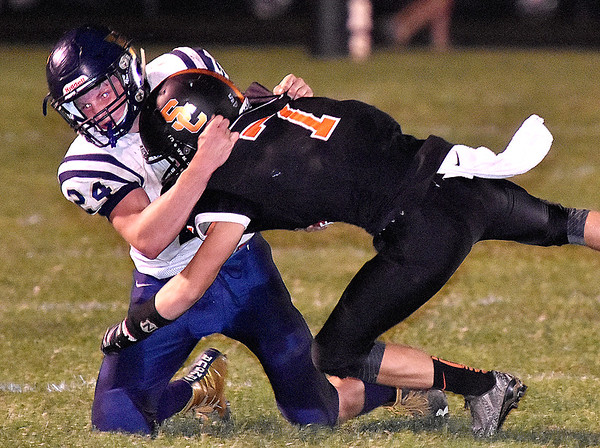 (Brad Davis/The Register-Herald) Greenbrier West's Chase Patterson takes down Summers County's Tucker Lilly Friday night in Hinton.